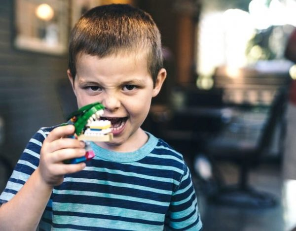 boy-with-toy-of-teeth