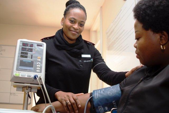 photo-of-woman-taking-blood-pressure
